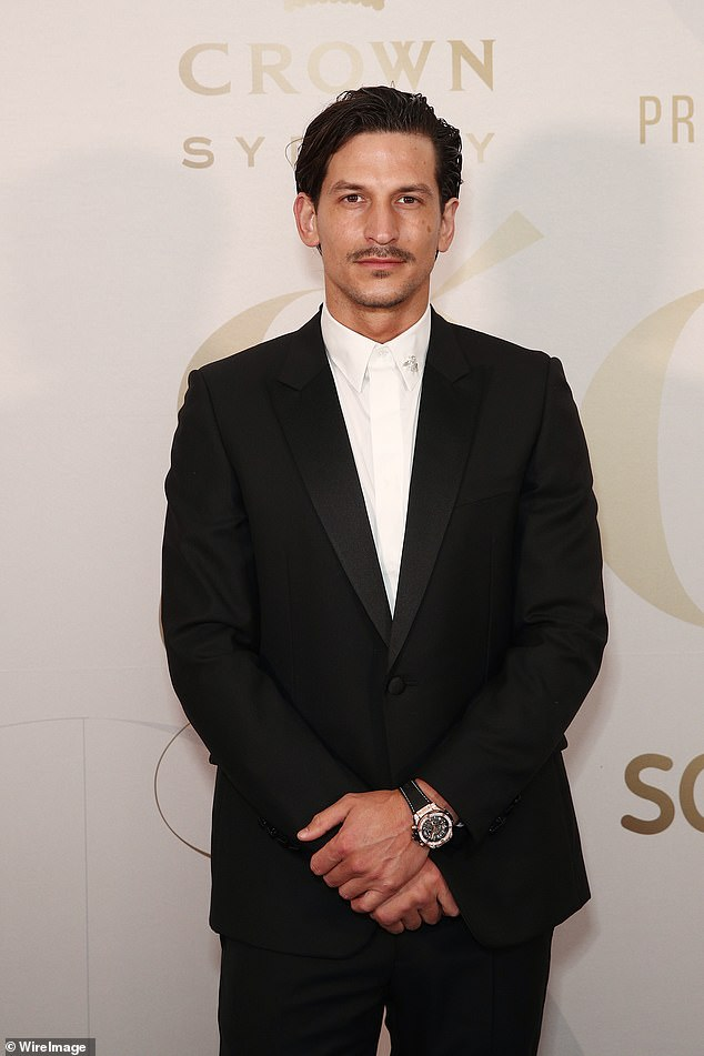 Strike a pose: Model Jarrod Scott (pictured) looked sharp in a black tuxedo and white buttoned shirt