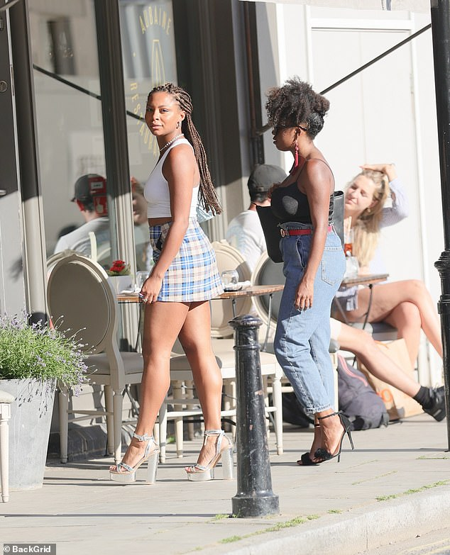 Style queen: Samira wore a blue and red plaid skirt while she carried a baby blue purse on her shoulder and completed her look with a pair of strappy silver platform heels