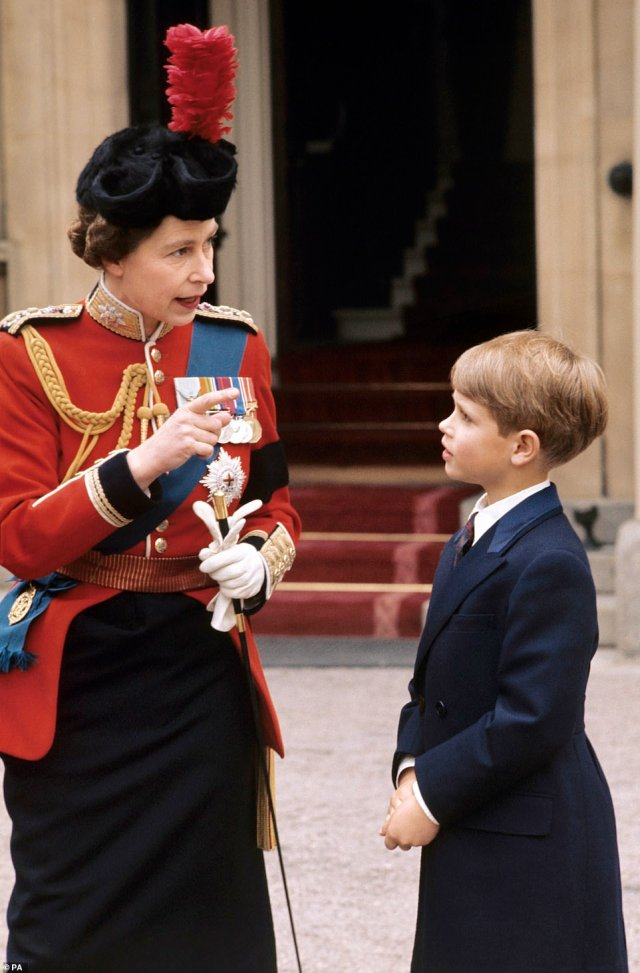 1972 — ALWAYS A MOTHER: The Queen explains the details of the Trooping the Colour to her youngest son Prince Edward at Buckingham Palace. Also in 1972, the Queen celebrated 25 years of marriage with Prince Philip.