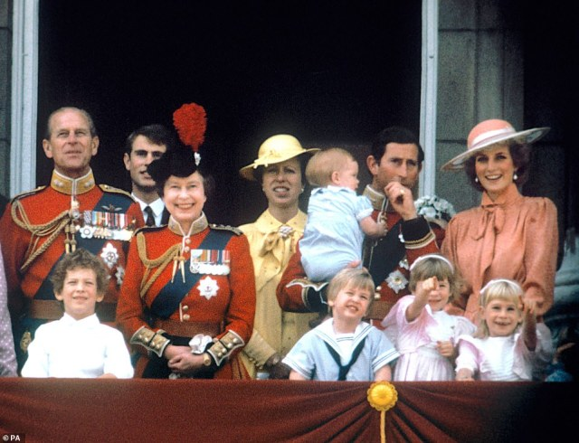 1985 — GRINNING GRANNY: A crowded balcony full of children and smiling faces saw the Queen beaming in 1985. Here: The Prince of Wales with the Princess of Wales, baby Prince Harry, Prince William, the Duke of Edinburgh, Prince Edward, Queen Elizabeth II and Princess Anne on the balcony of Buckingham Palace, London to watch the fly past.