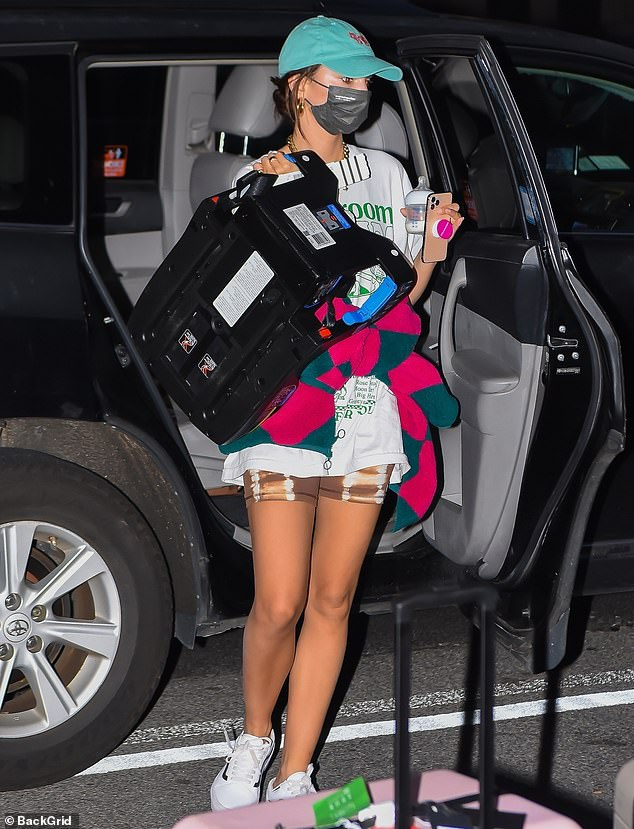Toned and tanned! Emily's golden skin was glowing as she stepped out of the black SUV while carrying Sylvester's car seat as the family returned to New York City on Thursday