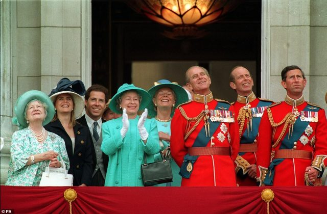 1993 — THREE CHEERS FOR THE QUEEN:The Queen leads members of the Royal Family in their applause for the flypast by the RAF, on the balcony at Buckingham Palace, at the end of the Trooping the Colour Ceremony. Notably absent from the photo: Diana, Princess of Wales.