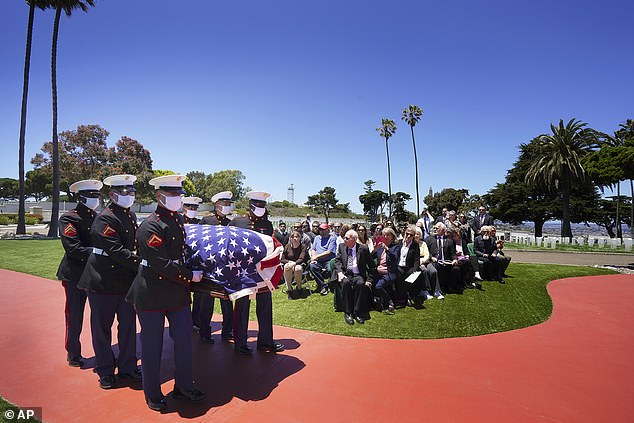 A military honor guard escorts the casket of Marine Corps, Pfc. John Franklin Middleswart for a full military honors at Fort Rosecrans National Cemetery