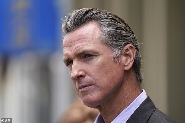 Jenner took to Twitter to defend her trip Down Under on Friday afternoon after reports emerged that she arrived in Sydney earlier that week, just two months before California's election to recall Governor Gavin Newsom (pictured) on September 14