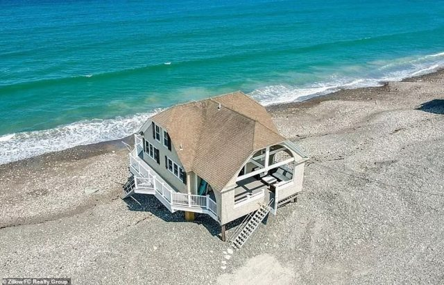Literal beach house: A nearly million-dollar beach home for sale in Massachusetts has perplexed social media users with its seemingly precarious location — directly on the beach, mere feet away from the water