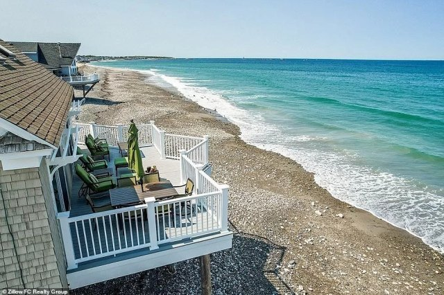 The house is purportedly located at 14 Stanton Lane, though photos of the exterior show no actual lane to speak of. It's been built on stilts directly in the sand of the beach, with an entire flight of stairs leading to the first floor of the two-story home