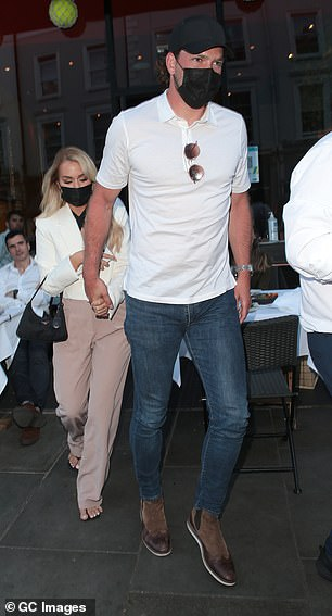 Style: Lottie, who is the younger sister of Louis Tomlinson, donned a white blazer for the evening which she wore with a black top and mauve trousers