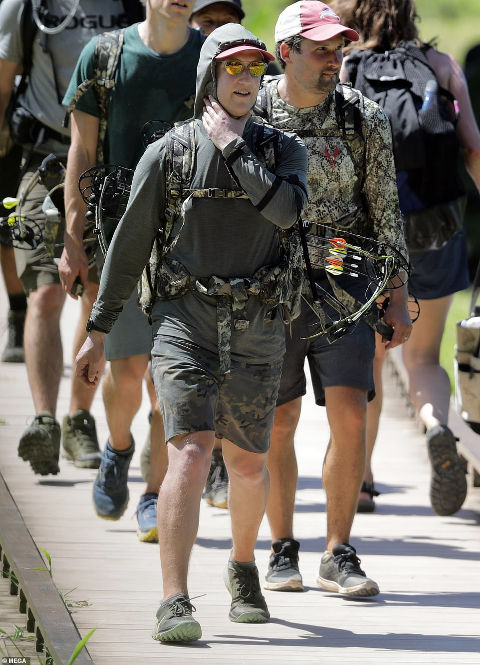 Feeling the heat? The Facebook CEO grabbed at his throat as he pounded the boardwalk before getting stuck into the rugged trail