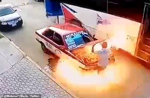 The engine caught fire moments after the driver opened the hood to inspect the vehicle