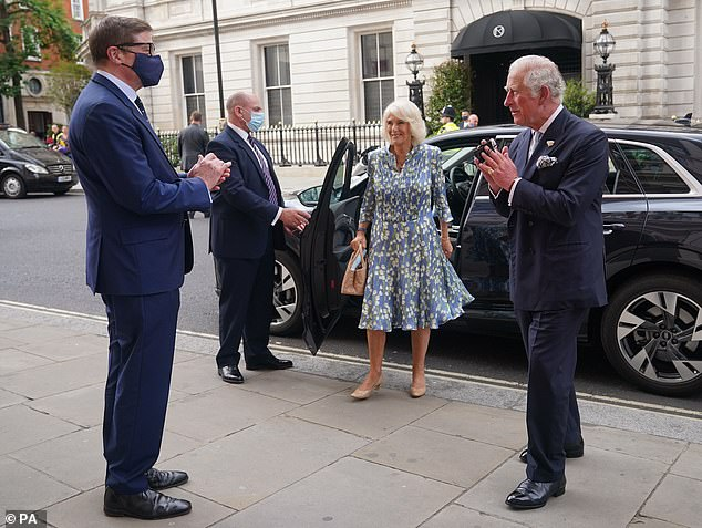 Charles (pictured right), who has been patron of the Royal Opera since 1975, looked equally charming in a smart suit with a light blue tie