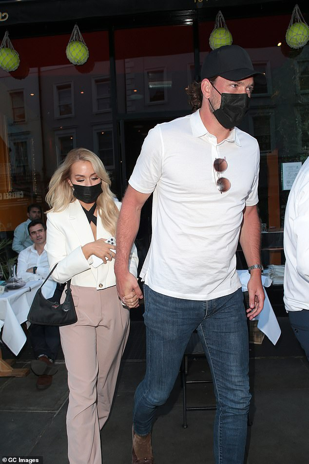 Romance: The couple held hands as they departed the swanky restaurant