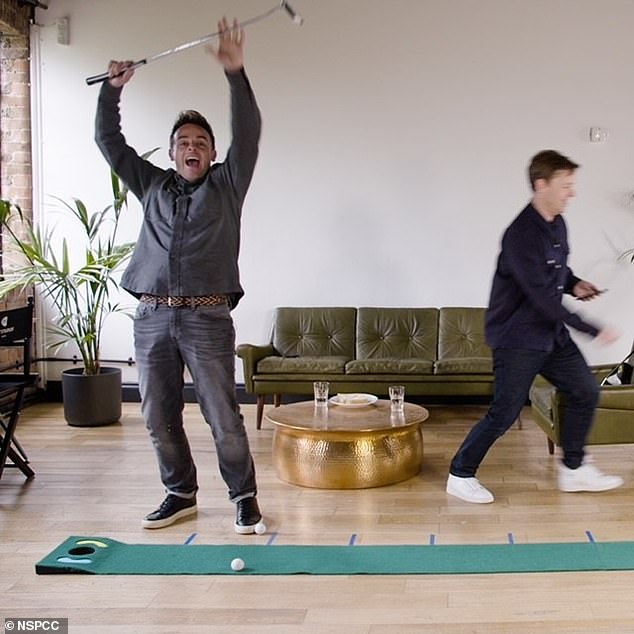 Fun:The TV presenters appeared in good spirits as they played a game of indoor golf together in a new clip