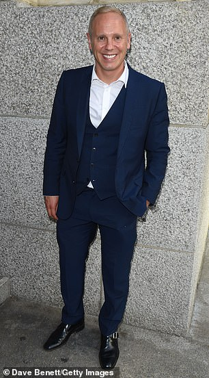 Dressed to the nines:Robert Rinder, who is known for hosting the reality courtroom series Judge Rinder, made an entrance in a navy three-piece suit and white shirt