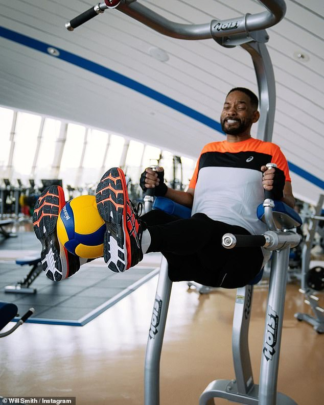 Doing the work: Will Smith, 52, shared a photo of himself doing weighted leg lifts while hoisted on equipment after declaring he was in 'the worst shape' of his life in May