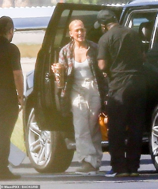 Take off: Jennifer Lopez was pictured aboard a private jet departing from Miami, Florida with her 13-year-old daughter Emme on Thursday afternoon