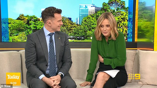 Fun: Rodger's guest-presenting role was teased at the end of the Today show shortly after 9am. Host Allison Langdon (right, with David Campbell) unexpectedly clutched her stomach and pretended she was unwell, before declaring: 'There's a doctor in the house!'