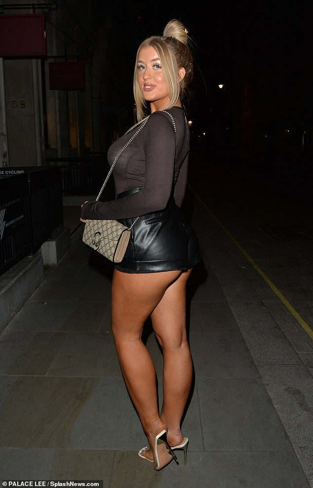 Wow: Jess, 22, flaunted her toned legs in a faux leather bottom that brushed her peachy bottom while her sister wore a plunging blazer dress and matching bottoms