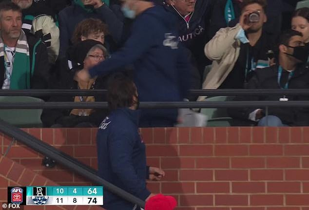 Seconds after the incident, Scott (pictured) was seenexchanging heated words with a security guard after a run in with a Port Adelaide fan, who he believes may have deliberately clipped him as he walked past