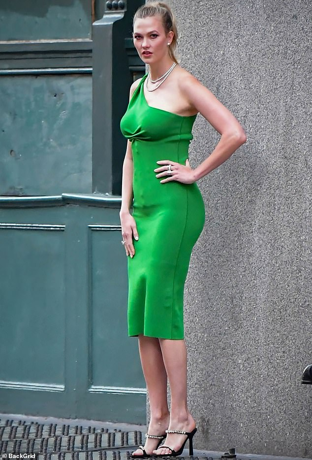 Here we go: The 28-year-old model draped her slender figure in a shiny bodycon green dress that came off the shoulder to one side