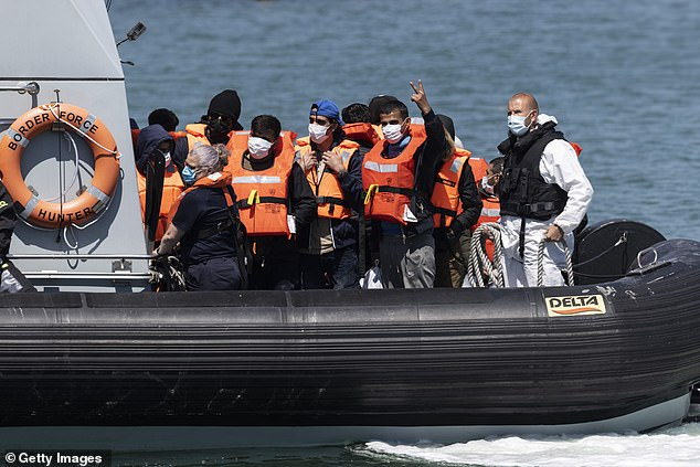 A border force vessel carries newly arrived migrants after being picked up in a dinghy in the English Channel yesterday