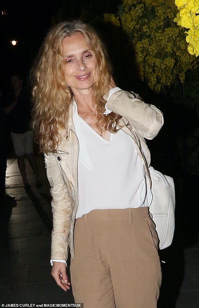 Style:The actress, 60, looked as youthful as ever and cut a chic figure in nude chinos as she left the swanky eatery after enjoying dinner
