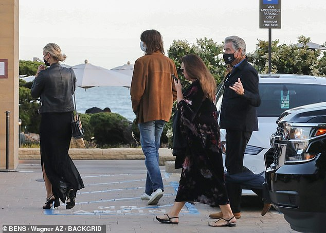 Family:Arriving for dinner at beach-front hotspot Nobu, the 007 star, 67, was joined by his 57-year-old wife Keely Shaye and their son Dylan, 24, who also looked sharp in a brown suede coat