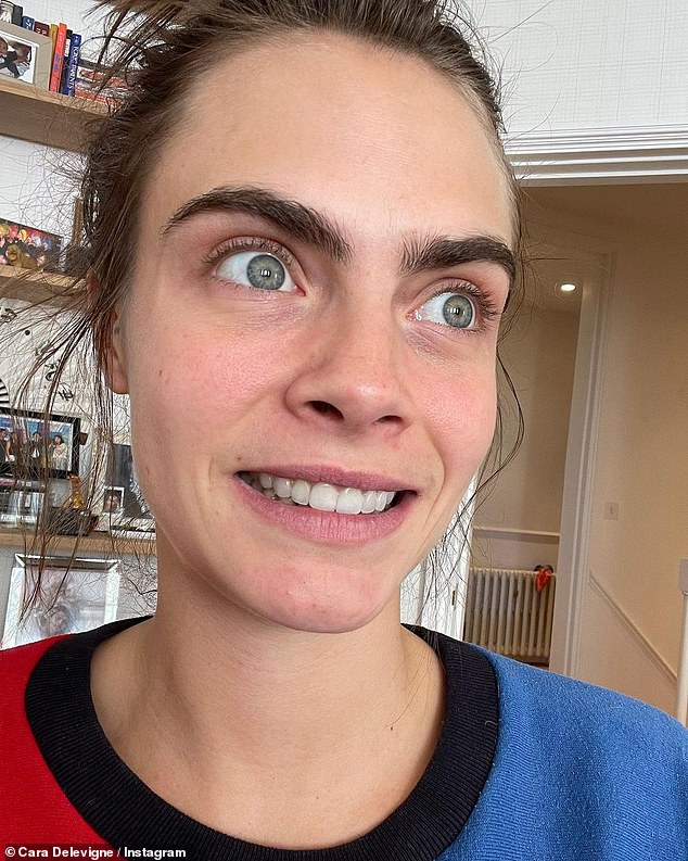 Quirky: Never one to take herself too seriously, Cara also shared an image of herself pulling a silly face while wearing a colourful red and blue jumper