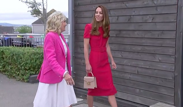 The Duchess of Cambridge, 39, cut an elegant figure in a red dress with matching shoes as she arrived to meet the President's wife Dr Jill Biden in Cornwall this afternoon
