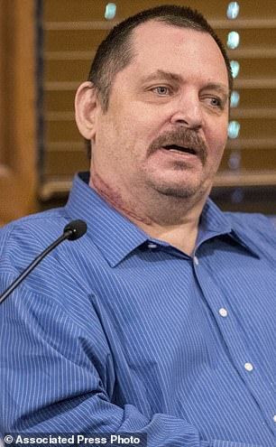 Trail, shown testifying at trial, tried to kill himself in custody by slashing his own throat