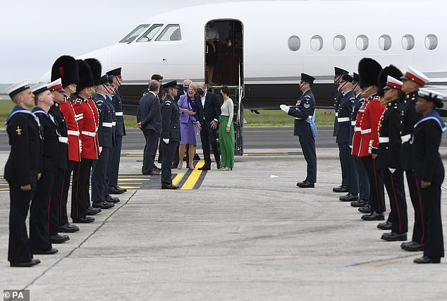President of the European Council, Charles Michel (centre) is welcomed as he arrives at Cornwall Airport Newquay ahead of the G7 summit, June 10
