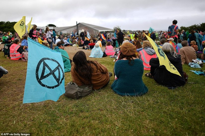 Hundreds of people gathered with Extinction Rebellion flags in St Ives to protest against inaction on climate change