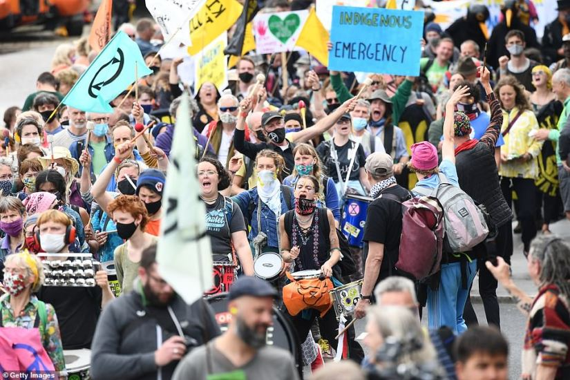 Banners read 'indigenous emergency' as drummers banged their instruments and others chanted