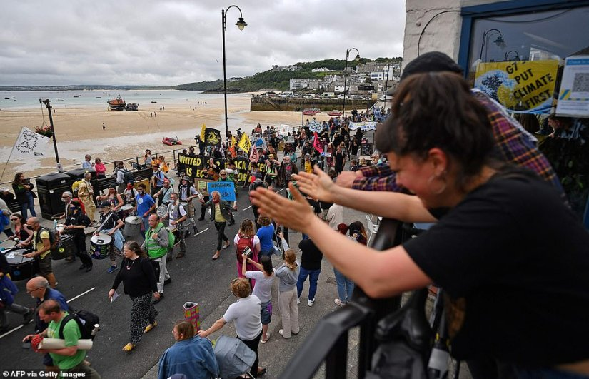 Residents clapped from balconies as they celebrated the protests happening below in St Ives
