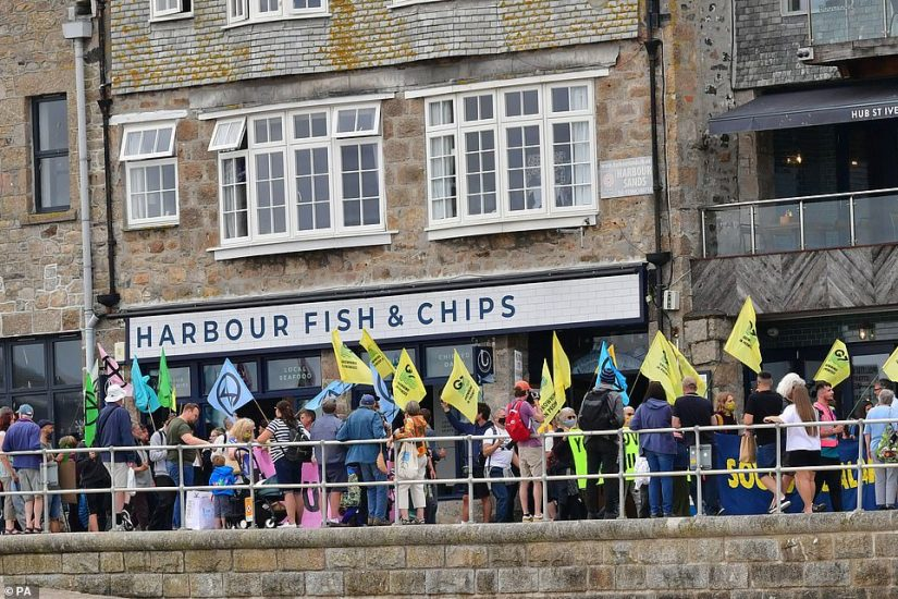 Protesters took a quick break to grab lunch at Harbour Fish and Chips shop in St Ives