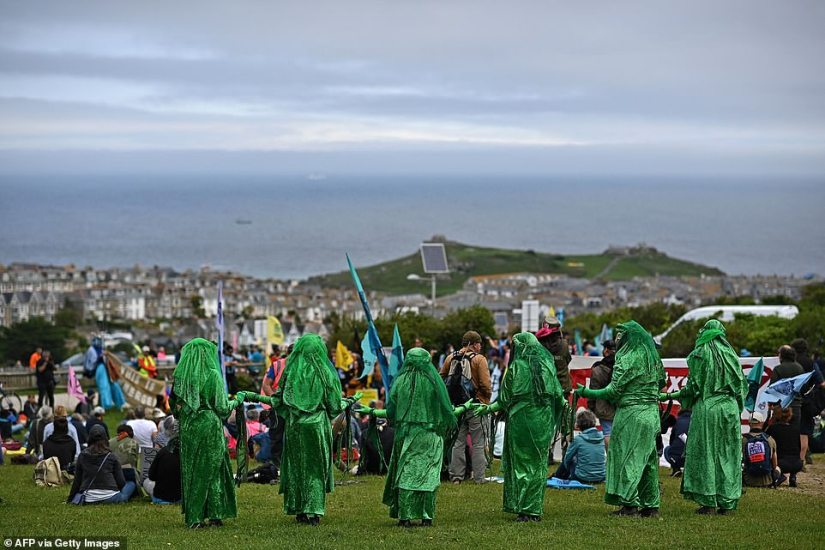 Some campaigners wore green gowns and veils and moved through crowd in a flowing motion, which they said represented the threat climate change has on marine life