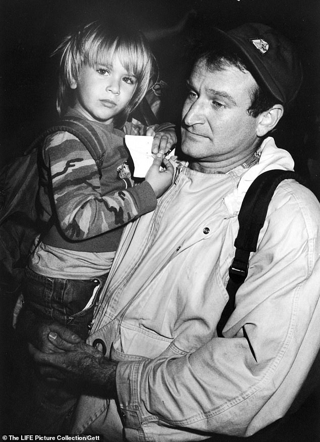 Going way back: Robin holding Zak in 1987. Zak describes his problems with substance abuse as 'generational,' Williams also vowed to 'break the cycle' now that he is a father himself