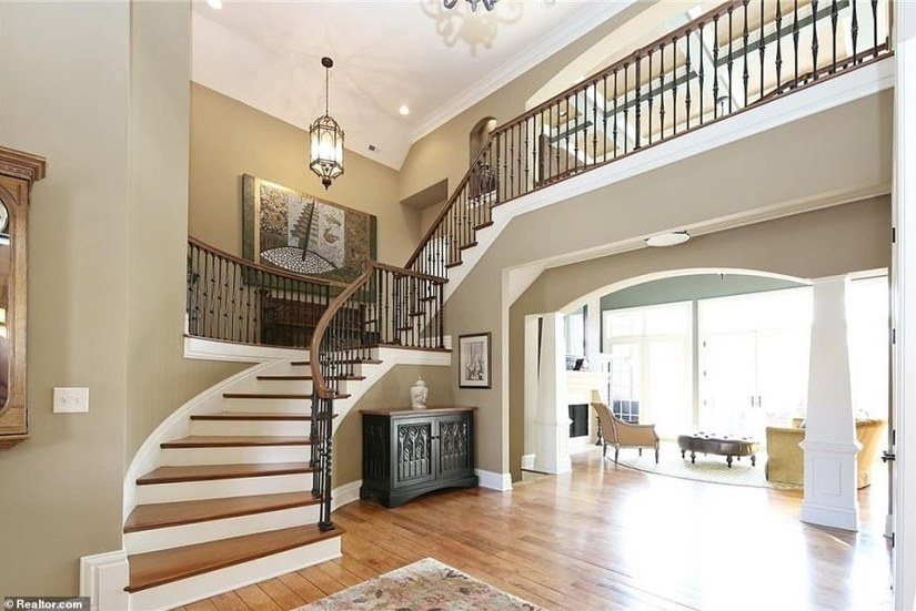 The stairway in former Vice President Mike Pence's new 'picturesque' 10,300 square-foot home he purchased in May for $1.93 million