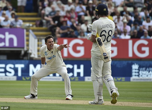 Trent Boult (left) became the fourth New Zealander to take 500 international wickets