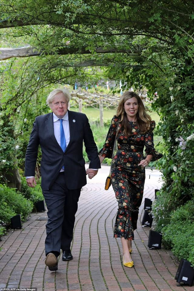 Arriving hand-in-hand her husband, Carrie (pictured right), 33, put her best fashion foot forward in the multi-coloured dress from The Vampire's Wife, teamed with yellow heels