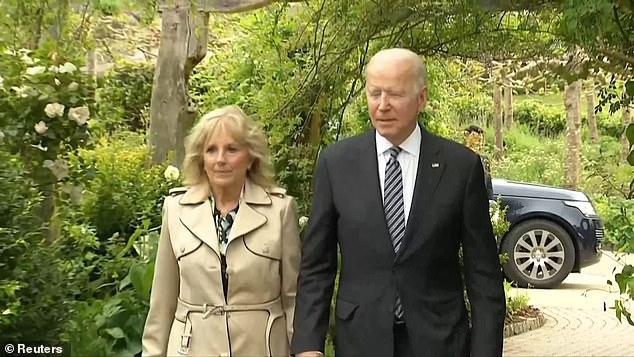 US President Joe Biden and First Lady Jill were also seen arriving as they walked underneath the leaf-covered arches and headed into the dinner