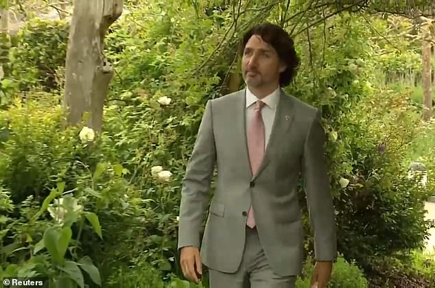 Canadian Prime Minister Justin Trudeau arrives for the reception, wearing a pink tie