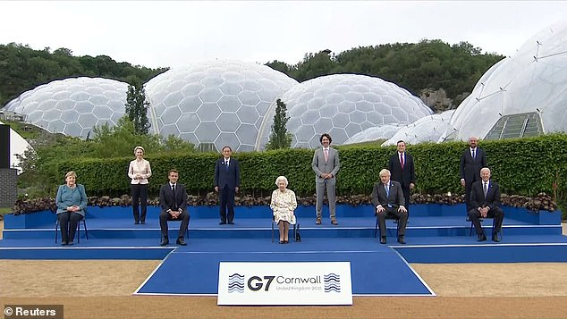 G7 leaders posed with the Queen for tonight's event in Cornwall. The domes of the Eden Project are seen in the background