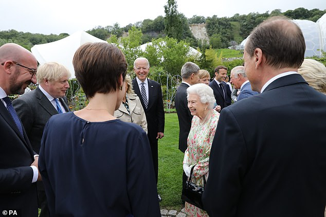 G7 leaders are seen speaking with the Queen at the Eden Project reception tonight