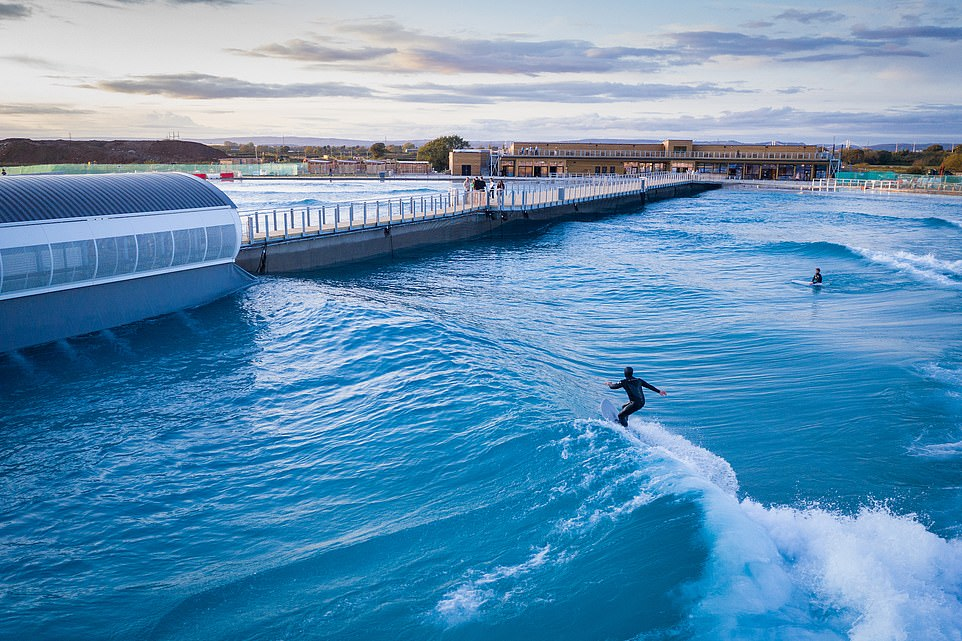 Catching waves: Surfers atThe Wave - a giant pool in Bristol shaped like a pizza slice where a reverberating machine can churn rideable waves