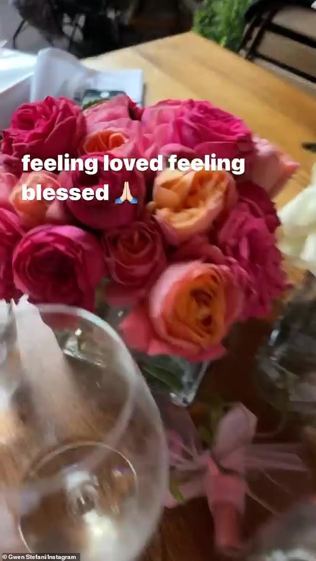Lovely:She featured a flower arrangement with red and orange roses and wrote, 'feeling loved feeling blessed,' adding a prayer hands emoji