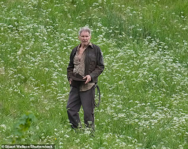 Back at it:Harrison Ford looked ready for action on Friday as filming continued for the highly anticipated movie in Leaderfoot, Melrose in the Scottish Borders