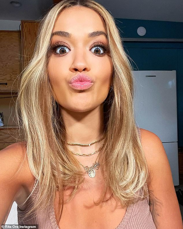 Cute: In amongst the unexplained pictures for her 'photo dump', Rita shared a selfie of herself pouting at the camera