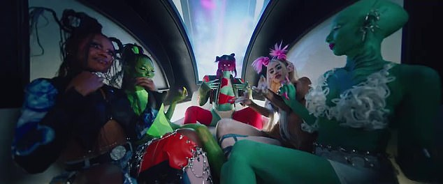 On the move:Grimes continues on in the music video as Doja and her girlfriends find themselves in a futuristic flying Uber that takes them through their city