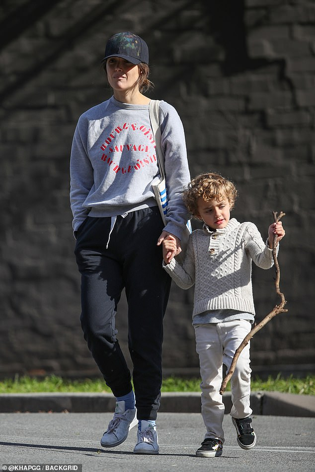 Outing:Rose Byrne has been back in her native Australia for some months, with her family in tow. On Saturday, the actress, 41, headed out for a stroll in Sydney with her son Rafa, three, in Sydney. Both pictured