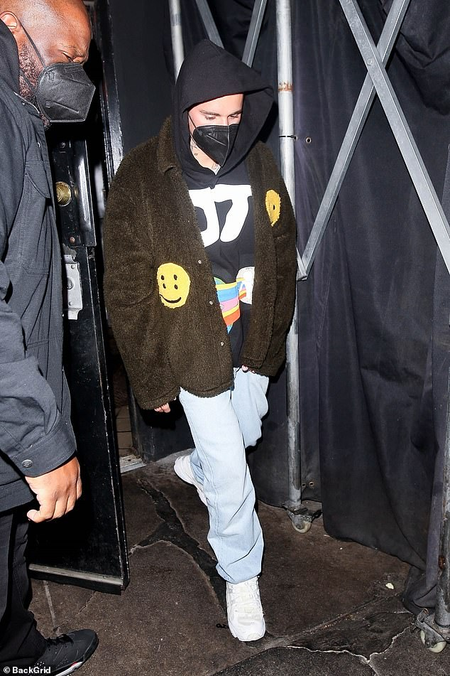 Casual: Perhaps attempting to fly under the radar, the Baby hitmaker pulled up his jacket's hood, and left the venue wearing a black face mask